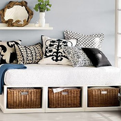 Stratton Daybed with Baskets & Tufted Cushion Set, Antique White - Designed to get the most out of your space and your budget, our Stratton Daybed's compact profile houses under-the-bed rattan baskets. Expertly crafted kiln-dried solid hardwood frame. Finished by hand on all sides using an exclusive technique that results in exceptional depth of color. Accommodates a twin mattress or daybed cushion (sold seperately). Wood swatches, below, are available for $25 each. We will provide a merchandise refund for wood swatches if they're returned within 30 days. View and compare with other collections at {{link path='pages/popups/bedroom_DOC.html' class='popup' width='720' height='800'}}Bedroom Furniture Facts{{/link}}. View our {{link path='pages/popups/fb-bedroom.html' class='popup' width='480' height='300'}}Furniture Brochure{{/link}}. Catalog / Internet Only.