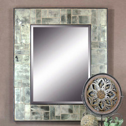 Grace Feyock Trory - Antiqued, tiled mirrors suround the center