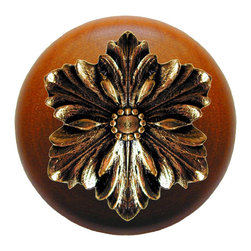 """Inviting Home - Opulent Flower Cherry Wood Knob (bright brass) - Opulent Flower Cherry Wood Knob with hand-cast bright brass insert; 1-1/2"""" diameter Product Specification: Made in the USA. Fine-art foundry hand-pours and hand finished hardware knobs and pulls using Old World methods. Lifetime guaranteed against flaws in craftsmanship. Exceptional clarity of details and depth of relief. All knobs and pulls are hand cast from solid fine pewter or solid bronze. The term antique refers to special methods of treating metal so there is contrast between relief and recessed areas. Knobs and Pulls are lacquered to protect the finish. Alternate finishes are available. Detailed Description: The Opulent Scroll pulls add an amazing focus to any drawers or cabinets - it will make them look regal and majestic. The absolute perfect place for these pulls to be used is in the dining room on your china closet. They are great pulls to use if you are trying to punch up an antique piece of furniture or cabinet. You should consider using the Opulent Scroll pulls in combination with the Opulent Flower knobs or wood knobs with flower."""