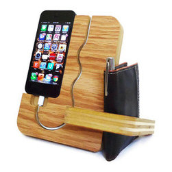 iPhone Valet - Organize the chaos of your desk with this multitasking iPhone Valet. Not only does it offer a charging station, but you can use the side deck for your office or small notebooks. The back also includes space for you to stash change, keys, paperclips, or other small items. Handcrafted out of oak plywood.