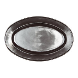 Pewter Stoneware Oval Platter - Medium - The shimmering grey of burnished pewter illuminates your table and your epicurean masterpieces when you present the Pewter Stoneware Oval Platter. The oval form is traditional, yet the sleek lines and minimalist design is decidedly modern. A dazzling addition to your dinnerware whether you're hosting a holiday fete or an impromptu gathering of dear friends.