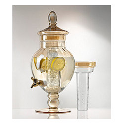 Artland - Bellini Gold Glass Beverage Server with Infuser & Ice Core - The ultimate sparkle is achieved with natural sunlight, however with an elegantly finished golden color, this beverage dispenser will sparkle through the night! Our high quality glass drink dispenser is a true eye catching piece of serve ware, sure to be treasured for generations to come. The ice core will keep drinks chilled without watering them down, while the infuser insert allows for that flavored fruity texture. Our exquisite beverage dispenser is footed, creating a beautiful centerpiece while quenching guests thirst. Treat your house guests to an elegant night of home entertaining or present as a hostess or birthday gift. Enjoy refilling your cup with some refreshing sangria, lemonade or mineral water with the flow of its sturdy spout!