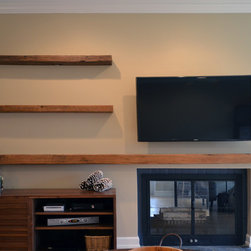 Reclaimed Lumber Floating Shelves - Reclaimed rustic barn wood was used to make these floating shelves. An outer shell hides the shelf supports while creating the illusion of a heavy solid barn beam. After sanding, it was finished with a water based flat polyurethane for protection and easy cleaning.