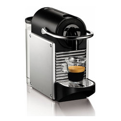 Frontgate - Nespresso Pixie Espresso Machine - Eye-catching design; compact size is great for small spaces. Removable 24 oz. water tank. Makes over 20 shots between refills. Patented coffee-capsule technology. Coffee-capsule sampler pack included. Brew a rich cup of delicious espresso in under a minute with our Nespresso Pixie Espresso Machine — no measuring, grinding, or tamping required. Simply insert a single-serving coffee capsule, pull the lever forward, and select your shot size; the 19-bar pressure pump automatically produces fresh crema espresso or lungo every time. . .  .  . .  . 3' cord, 120V . Water-level detection indicators are backlit by LED lights. Convenient integrated power cord storage for easy transportation. Hand wash water tank, capsule container and drip tray. Wipe base clean with a damp cloth . Made in Switzerland. Coffee capsules are easy to order; for details, visit nespresso.com.