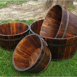 "Shine Company Inc. - Wood Round Shallow Cedar Barrel Planters (Set of 4) - Our back to nature barrels, offered in antique gray, are great as planters or storage containers. Their classic, simple designs bring out the beauty of their natural cedar wood construction. Features: -Barrel set of four.-Made of solid cedar.-Round shape.-Premium, high quality yellow Cedar wood known for its natural resistance to moisture, decay, and insect damage.-Classic whiskey barrel shape.-Drainage holes in base of barrel.-Rust resistant galvanized steel hardware.-Functional and practical to use it indoors and out on patios, decks and lawns.-Comes with 4 different sized barrels.-Handles not included.-Material: Cedar Wood.-Recommended Plant Type: Any.-Water Resistant: Yes.-Warp Resistant: Yes.-Rot Resistant: Yes.-Crack Proof: No.-Fade Resistant: No.-Liner: No.-Mounting Brackets Included: No.-Handles: No.-Self Watering: No.-Handmade: Yes.-Hand- painted: Yes.-Illuminated: No.-Distressed: Yes.-Recycled Content: 0%.Dimensions: -Assembled Dimensions Height (Small) : 7"".-Assembled Dimensions Height (Medium) : 8"".-Assembled Dimensions Height (Large) : 9"".-Assembled Dimensions Height (Extra Large) : 10"".-Assembled Dimensions Width (Small) : 12.5"".-Assembled Dimensions Width (Medium) : 15"".-Assembled Dimensions Width (Large) : 18"".-Assembled Dimensions Width (Extra Large) : 20.5"".-Assembled Dimensions Depth (Small) : 12.5"".-Assembled Dimensions Depth (Medium) : 15"".-Assembled Dimensions Depth (Large) : 18"".-Assembled Dimensions Depth (Extra Large) : 20.5"".-Assembled Weight: 18 lbs.Assembly: -Assembly Type: No assembly required.Warranty: -Product Warranty: 1 year."