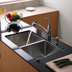 Kraus - Kraus KHU102-33-KPF2110-SD20 Double Basin Undermount Kitchen Sink with Faucet Mu - Shop for Kitchen from Hayneedle.com! Bring sleek elegance into your kitchen with the Kraus KHU102-33-KPF2110-SD20 Double Basin Undermount Kitchen Sink with Faucet and its inspired design. Just give the single handle of the faucet a lift to spring it to life and a touch of the button transforms it into a strong sprayer to rinse produce and dishes. A pair of large stainless steel basins makes for great multitasking to keep you on track.Product SpecificationsNumber of Basins: 2Bowl Depth (inches): 10Weight (pounds): 39Low Lead Compliant: YesEco Friendly: YesMade in the USA: YesHandle Style: LeverValve Type: Ceramic DiscFlow Rate (GPM): 2.2Spout Height (inches): 7.5Spout Reach (inches): 8.5About KrausWhen you shop Kraus you'll find a unique selection of designer pieces including vessel sinks and faucet combinations. Kraus incorporates its distinguished style with superior functionality and affordability while maintaining highest standards of quality in its vast product line. The designers at Kraus are continuously researching and exploring broader markets seeking new trends and styles. Additionally durability and reliability are vital components at Kraus for developing high-quality fixtures. Every model undergoes rigorous testing and inspection prior to distribution with customer satisfaction in mind. Step into the Kraus world of plumbing perfection. With supreme quality and unique designs you will reinvent how you see your bathroom decor. Let your imagination become reality!