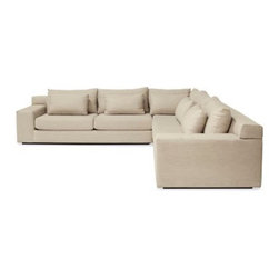 Design Within Reach - Simpatico Corner Sectional - The handcrafted Simpatico Collection (2010) delivers comfort and elegance in one exquisite package. Wonderfully simple and with barely a seam in sight, there's a gracefulness to the shape of these pieces. Upholstered with what's called waterfall tailoring, the cushions and frames are sewn with one continuous piece of fabric wrapping over the front, from top to bottom or side to side. The cushions are finished with a boxing strip around the sides and constructed without welting or visible stitches. It takes expertise and careful planning to upholster this way, but before you think Simpatico sounds too precious for everyday living, think again. Deep seats, wide armrests (a magnificent perch for your laptop) and down-blend throw pillows make Simpatico a great place to hang out. Adjust the back cushions to find your perfect seat depth or stretch out for a comfortable nap.†