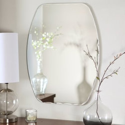 Frameless Freddie Wall Mirror - 23.5W x 32.5H in. - Every home needs at least one beautiful mirror and the Frameless Freddie Wall Mirror is the perfect design. This stunning mirror's shape is between oval and rectangular for a unique piece that adds a beautiful contemporary element to any wall. Constructed of metal and strong 3/16 glass this mirror features a rare bevel and V-grooved cut design around the border. Mounting hardware is included with the mirror. Weighs 14 pounds. Dimensions: 23.5W x .5D x 32.5H inches.