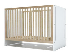 Spot on Square - Oliv Crib - The Spot on Square Oliv Crib is modestly modern offering high quality craftsmanship with an equally modest price tag. The Oliv crib brings a clean modern aesthetic with a touch of warmth through the contrast of birch on white. Three adjustable positions for the mattress platform allow you to adjust the height to grow with your baby. Toddler daybed conversion available.