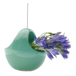 Jadeite Hanging Vase - Suspend flowers and succulents in midair in this basket-shaped planter or vase. Any hook in the house can become a spot for some color and greenery, or you can add a few removable hooks for a full hanging garden. The soft green shade looks great against pink or yellow blossoms.