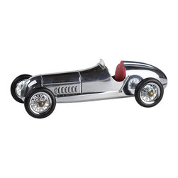 "Inviting Home - Silberpfeil Desk Racer with Red Seat - Silberpfeil racecar model with red seat 12-1/8"" x 5-1/8"" x 3-5/8""H The 1930s saw the rise of hand built model racecars known as Spindizzies or tether cars. Miniature racecars built by hobbyists zoomed around banked wooden tracks at speeds approaching 150 miles per hour. Resembling the full-size racers of their day several Spindizzies competed at once tethered by cables to a central pole. Powered by model airplane engines spindizzies raced against the clock. Incredibly detailed and aerodynamic these miniature racecars were beyond toys; they were pieces of art representative of the best pioneering technology of the era."