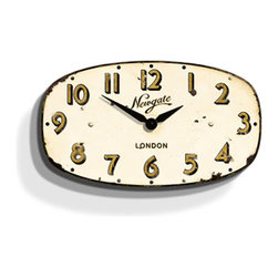 Vintage Wall Clock - Cream - Throw your kitchen or living room a retro vibe with this cream Vintage Wall Clock. An oval dial and slightly distressed appearance lend the timepiece a vintage look that would make it work well above a doorway or as the crowning timepiece in the kitchen.