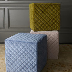 Cube Ottoman - Pulling up a chair can be a hassle, and that's why I opt for easy-to-access cube ottomans. These quilted ones from Neiman Marcus come in a variety of colors and can double as a coffee table or side table — the opportunities are endless. Just don't only buy one; you always need a pair.