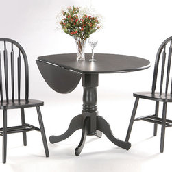 International Concepts - Drop Leaf Dinette Set in Black Finish - You'll enjoy the pleasing features of this dinette set that comes with a solid wood table with two drop leaves that allow you to transform it from a round table to a rectangular one.  The two complementing chairs have distinctively decorated round backs. * Solid wood dual dropleaf table. Some assembly required. Chairs fully assembled. 42 in. W x 42 in. D x 29.5 in. H