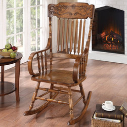 Coaster - Oak Rocking Chair - This simple wood rocker will look great in your casual or traditional style home. The lovely porch style rocking chair has a simple look, with a straight vertical slat back and an ornamental headrest pattern. In an oak finish, this rocking chair will complement your decor