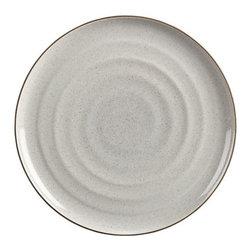 """18th St. Dinner Plate - Modern and restrained in form, expressive and rustic in glaze. The artisan's hand is authentically reproduced in this stoneware pattern designed exclusively for Crate and Barrel by ceramic artist and designer Kathy Erteman at her 18th Street studio in New York City. A contemporary matte black exterior contrasts the rustic beauty of a shiny, speckled white glazed interior ringed with the subtly raised spiral associated with hand-thrown pieces. A raised clay rim features a sandy glaze that evokes the feel of exposed terra cotta. To capture the artisan look of this dinnerware, Erteman modeled prototypes to true scale by hand with her original glazes as reference for production. In the words of the designer, """"When making tableware, I consider design and the rigors of daily use. The spirit of my hand in these pieces is modest, to harmonize with and act as a support to the prepared ingredients."""""""