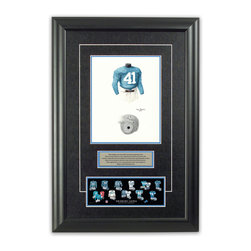 """Heritage Sports Art - Original art of the NFL 1938 Detroit Lions uniform - This beautifully framed piece features an original piece of watercolor artwork glass-framed in an attractive two inch wide black resin frame with a double mat. The outer dimensions of the framed piece are approximately 17"""" wide x 24.5"""" high, although the exact size will vary according to the size of the original piece of art. At the core of the framed piece is the actual piece of original artwork as painted by the artist on textured 100% rag, water-marked watercolor paper. In many cases the original artwork has handwritten notes in pencil from the artist. Simply put, this is beautiful, one-of-a-kind artwork. The outer mat is a rich textured black acid-free mat with a decorative inset white v-groove, while the inner mat is a complimentary colored acid-free mat reflecting one of the team's primary colors. The image of this framed piece shows the mat color that we use (Light Blue). Beneath the artwork is a silver plate with black text describing the original artwork. The text for this piece will read: This original, one-of-a-kind watercolor painting of the 1938 Detroit Lions uniform is the original artwork that was used in the creation of this Detroit Lions uniform evolution print and tens of thousands of other Detroit Lions products that have been sold across North America. This original piece of art was painted by artist Tino Paolini for Maple Leaf Productions Ltd. Beneath the silver plate is a 3"""" x 9"""" reproduction of a well known, best-selling print that celebrates the history of the team. The print beautifully illustrates the chronological evolution of the team's uniform and shows you how the original art was used in the creation of this print. If you look closely, you will see that the print features the actual artwork being offered for sale. The piece is framed with an extremely high quality framing glass. We have used this glass style for many years with excellent results. We package ever"""