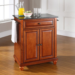 Crosley - Cambridge Kitchen Island with Granite Top - This kitchen island is designed for longevity. Panel doors and drawer front provide the ultimate in style to dress up your kitchen. The deep drawer is great for anything from utensils to storage containers. Behind the two doors, you will find an abundance of storage space for things that you prefer to be out of sight. Style, function, and quality make this kitchen island a wise addition to your home. Features: -Solid black granite top.-Two towel bars.-Beautiful raised panel doors.-Distressed: No.-Product Type: Compact kitchen cart.-Counter Finish: Granite.-Powder Coated Finish: No.-Gloss Finish: No.-Base Material: Hardwood and veneers.-Hardware Material: Steel.-Solid Wood Construction: No.-Exterior Shelves: No.-Drawers Included: Yes -Number of Drawers: 1.-Push Through Drawer: No.-Dovetail Joints: No.-Drawer Dividers: No.-Drawer Handle Design: Knob.-Silverware Tray : No..-Cabinets Included: Yes -Number of Cabinets : 1.-Double Sided Cabinet: No.-Number of Interior Shelves: 1.-Adjustable Interior Shelves: Yes.-Number of Doors: 2.-Magnetic Door Catches: Yes.-Locking Doors: No.-Door Handle Design: Knob..-Towel Rack: Yes -Removable Towel Rack: No..-Pot Rack: No.-Spice Rack: No.-Cutting Board: No.-Drop Leaf: No.-Drain Groove: No.-Trash Bin Compartment: No.-Stools Included: No.-Wine Rack: No.-Stemware Rack: No.-Cart Handles: No.-Finished Back: Yes.-Swatch Available: No.-Commercial Use: No.-Recycled Content: No.-Eco-Friendly: No.-Product Care: Use a soft clean cloth that will not scratch the surface when dusting. Use of furniture polish is not necessary. Should you choose to use a furniture polish, test in an inconspicuous area first. Use of solvents of any kind could damage your furniture's finish. To clean, simply use a soft cloth moistened with lukewarm water, then buff with a dry soft clean cloth..-Hardware Finish (Base Finish: Black): Brushed nickel.-Hardware Finish (Base Finish: Classic Cherry): Antique brass.-Hardw