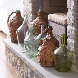 Ballard Designs - Found Wicker Demijohn - Hand blown glass. Sizes and finishes will vary. We found these authentic demijohns while hunting for hidden treasure in a European flea market. Originally, they were probably used to store wine. Now they make wonderful accent pieces just about anywhere from the hearth to outdoor porch. Found Demijohn features: . .