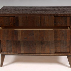 The Hemingway Chest - Shown in rough sawn antique pine with a bourbon finish, the Hemingway Chest, made of reclaimed wood, is a gorgeous addition to your living room or bedroom. It features classic styling, a unique splayed leg design, and the handcrafted quality you've come to expect from Reclamation Company. The wood was reclaimed from barns across the Southeastern United States, mostly built around the turn of the 20th century and prior.