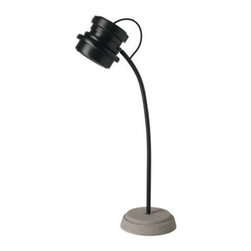 """Diesel - Diesel Tool Table Lamp - The Tool Table lamp has been designed by Diesel in 2010 and made in Italy by Foscarini.  This lamp has been designed with a single rubber body, its form reminiscent of a foundry mould or a piece of engineering straight from the lathe.  Tool lights up the rough vintage environment of factories and workshops, with shapes and materials derived from the pull of technology in its raw state.  Transmitted is the impression of an object fresh off the assembly line and destined for a home environment unafraid to break with design and aesthetic conventions.  Product Details: The Tool Table lamp has been designed by Diesel in 2010 and made in Italy by Foscarini.  This lamp has been designed with a single rubber body, its form reminiscent of a foundry mould or a piece of engineering straight from the lathe.  Tool lights up the rough vintage environment of factories and workshops, with shapes and materials derived from the pull of technology in its raw state.  Transmitted is the impression of an object fresh off the assembly line and destined for a home environment unafraid to break with design and aesthetic conventions. Details:                                     Manufacturer:                                      Diesel by Foscarini                                                     Designer:                                     Foscarini                                                     Made in:                                     Italy                                                     Dimensions:                                      H: 22 7/8"""" ( 58cm) X D: 6 5/16"""" (16 cm)                                                      Light bulb:                                      1 X 20W GU10 type MR16 Halogen                                                     Material:                                      Silicone rubber and concrete"""