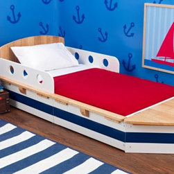KidKraft Boat Toddler Bed - Your child can pretend that he's sailing the high seas in this bed without any worries of seasickness and that means bedtime is happy and more fun than ever. Crafted of solid rubberwood this boat is constructed with high quality to withstand the rigors of child use. It features cute portholes on the sides which serve as bed rails to keep your child safe all night long. Storage space is hidden underneath the boat to store books and toys and the entire boat is made low to the ground for easy access. The recommended age for this bed is 15 months and up and the maximum weight capacity is 50 pounds. Minor assembly required. Dimensions: 72.5L x 32W x 20.25H inches.About KidKraftKidKraft is a leading creator manufacturer and distributor of children's furniture toy gift and room accessory items. KidKraft's headquarters in Dallas Texas serve as the nerve center for the company's design operations and distribution networks. With the company mission emphasizing quality design dependability and competitive pricing KidKraft has consistently experienced double-digit growth. It is a name parents can trust for high-quality safe innovative children's toys and furniture.