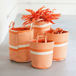 Orange Crush Woven Baskets - This stylish set of storage baskets is both functional and attractive. Great for organizing laundry, storing extra towels, or holding anything else that's accumulating in your home, they're durable and, thanks to their sturdy handles, easy to move even when they're loaded up.