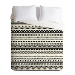 Aztec Way Duvet Cover - With this striking duvet cover there's only one way to display it: the Aztec way. Let its patterns speak for themselves by keeping surrounding textiles simple.