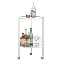 Ernest White Bar Cart - Every beach house needs a bar cart; this CB2 rolling bar table is multifunctional and can be moved from the indoors to outdoors and room to room depending on where guests are gathering.