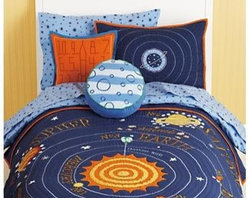 Kids Blue Solar System Bedding - This solar system quilt features our eight official planets orbiting the sun. (Sorry, Pluto.) But the bedding pays homage to the little dward planet with a throw pillow. This bedding is out of this world.