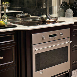 """GE Monogram Induction Cooktop - Thanks to the GE Monogram 36"""" induction cooktop's shallow-depth configuration and integrated cooling system, you can install it above a Monogram single wall oven."""