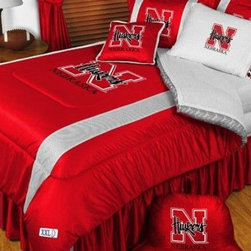 Sports Coverage - Nebraska Cornhuskers NCAA Bedding - Sidelines Comforter and Sheet Set Combo - Qu - This is a great Nebraska Cornhuskers NCAA Bedding Comforter and Sheet set combination! Buy this Microfiber Sheet set with the Comforter and save off our already discounted prices. Show your team spirit with this great looking officially licensed Comforter which comes in new design with sidelines. This comforter is made from 100% Polyester Jersey Mesh - just like what the players wear. The fill is 100% Polyester batting for warmth and comfort. Authentic team colors and logo screen printed in the center.   Microfiber Sheet Hem sheet sets have an ultrafine peach weave that is softer and more comfortable than cotton.  Its brushed silk-like embrace provides good insulation and warmth, yet is breathable.  The 100% polyester microfiber is wrinkle-resistant, washes beautifully, and dries quickly with never any shrinkage. The pillowcase has a white on white print beneath the officially licensed team name and logo printed in vibrant team colors, complimenting the NEW printed hems. The Teams are scoring high points with team-color logos printed on both sides of the entire width of the extra deep 4 1/2 hem of the flat sheet.  Includes:  -  Flat Sheet - Twin 66 x 96, Full 81 x 96, Queen 90 x 102.,    - Fitted Sheet - Twin 39 x 75, Full 54 x 75, Queen 60 X 80,    -  Pillow case Standard - 21 x 30,    - Comforter - Twin 66 x 86, Full/Queen 86 x 86,