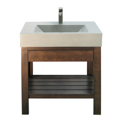 Concrete Sink - Trueform Concrete - The simple and refined design of the Lavare Collection makes it wonderful addition to any room's design. On this model, the cherry wood base comes complete with a soft close U-shaped drawer for toiletries and a slotted shelf for towels or decorative baskets.