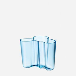 "iittala - 4.75"" Alvar Aalto Vase in Light Blue - The undulating forms of the objects in the Aalto collection are like the Finnish landscape with its thousands of lakes - beautiful, alive and untamed. Glassblowers at the Iittala factory still meticulously handcraft the legendary vases that are variations on one theme, fluid organic shapes that let the end user decide the use. Interpretations of the shape in new colors and materials add to the growing Alvar Aalto Collection and remain true to his original design idea. Features: -Organic form. -Height: 4.75""."