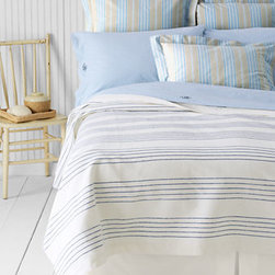 Woven Stripe Coverlet - I'd love to wake up under this blue and white stripy coverlet. It looks so fresh and inviting that it would probably make me enjoy making my bed in the morning.