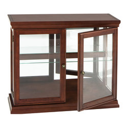 Holly & Martin - Arabella Double-Door Curio-Mahogany - Traditional styling and a rich mahogany finish make this curio cabinet perfect for any room in your home. Matching shoe and crown molding enclose the cabinet while glass paned doors and side panels draw your eyes to all of your wonderful collectables. The inside of the cabinet has a large mirror back that visually adds depth while the clear fixed glass shelf divides the space in half, making room for a wide variety of items. This gorgeous curio cabinet is perfect in the dining room, entryway, or living room.