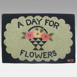 Susan Branch - Susan Branch A Day For Flowers Rug - SB-0085 - Shop for Rugs and Runners from Hayneedle.com! The Susan Branch A Day For Flowers Rug says it all. This rug is just right for patios or flower shops and features a flower basket design with a fun slogan. Hand-hooked from 100% wool it measures 36L x 24W inches. A density of 90 lines per square foot gives it a dense tight texture that stands up to years of use yet remains soft and luxurious. Designed for indoor use in residential or commercial settings.About Thorndike MillsRooted in a proud Armenian family tradition Thorndike Mills developed in Boston during the first half of the 20th century. Their dedication to the quality traditions of Armenian rug-making remains true today. With an emphasis on exact specifications materials that meet high levels of quality and rigorous construction standards they're a top producer of braided rugs for homes and businesses across America. Thorndike Mills is the only manufacturer who still produces true cloth braided rugs made with three strands woven together and then wrapped; the next best option would be a handmade rug. The true quality of the rugs lies in the little details like hidden joints guaranteed color matching perfect symmetry of design and durable lock-stitch sewing. Thorndike Mills is still owned today by the third generation of the founding family.About Susan BranchSusan Branch is a self-taught artist from the Martha's Vineyard area who creates delicate organically inspired works that celebrate nature and simplicity. She has previously been featured in magazines including Country Living and American Patchwork and Quilting. Susan is best known for her beautiful watercolor illustration work which graces her 14 published books as well as a line of china stationery pajamas and her popular yearly calendar.