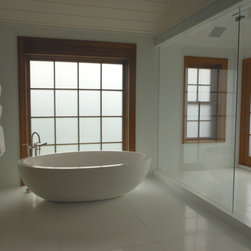 Bathroom Privacy Windows & Decorative Electronic Glass for Showers - This high-profile Hamptons resident chose LC Privacy Glass for their entire master suite & bathroom. They ordered finished doors and windows with LC Privacy Glass complete with decorative SDL grills. The floor to ceiling window next to their bathtub changes from transparent to opaque at the touch of a button.