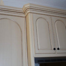 Traditional Kitchen by Magnifico Cabinet Refinishing