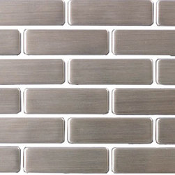 """Susan Jablon Mosaics - Half Sheet of Stainless Steel Subway Tile - This stainless steel tile is shaped into ¾"""" x 2 1/2"""" stainless steel mosaic tile in a running brick orientation. This selection is truly a classic statement that works with any counter top. Stainless steel tile is very easy to care for.This 8mm thick, 3/4 x 2 1/2 inch subway stainless steel tile has a stylish brushed gray, silver metallic surface. Absolutely perfect for your kitchen backsplash, this pairs with any countertop surface you have chosen. The construction of this tile is a porcelain core that is wrapped with stainless steel on the top and on all the sides. It can be cut with a wet saw during installation.It is very easy to install as it comes by the square foot on mesh and it is very easy to clean!"""
