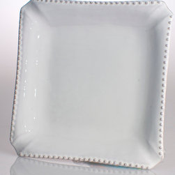 Charlot Dinner Plate - The weighty style and country-chateau feel of transitional square dinner plates takes an artisan spin with the Charlot Dinner Plate, a charming square dish with a classic beaded rim.  This cream-hued design is made with care so you can easily coordinate a setting with intriguing geometry on any dining table; blunted corners give a tailored, crafted look to the square plate's shape.