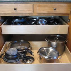 Kitchen Pull Out Shelves - Full-extension pull out shelves from ShelfGenie of Pittsburgh are custom made to fit your existing cabinets and closets.  The shelves hold up to 100 pounds and glide easily with the touch of a finger.