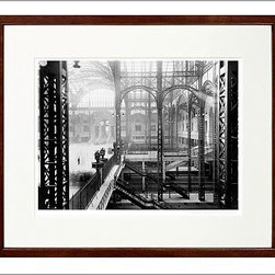 """New York Times Archive Framed Photography, Old Pennsylvania Station Interior - 1 - Located in the center of Manhattan, the original Pennsylvania Station was one of New York's architectural gems, a breathtaking example of Beaux Arts design and craftsmanship. In this gorgeous photograph, the train shed and main waiting room are the focus, with the elaborate ironwork backlit by sunlight and shadows. Demolished in 1963, this station was photographed in all of its glory during a high point in train travel. This image was preserved in The New York Times Archive and we're proud to offer it as a beautiful tribute to a bygone era. 14"""" wide x 12"""" high (10 x 8"""" mat opening) 20"""" wide x 16"""" high (14 x 11"""" mat opening) 24"""" wide x 20"""" high (20 x 16"""" mat opening) Selected from the historical images of the New York Times archives. Includes a certificate of authenticity from the New York Times. Backed with a label giving time period and full story of the image. Offered exclusively through Pottery Barn. Framed in ramin wood with a black or espresso finish. White archival-quality, acid-free, beveled-cut mat. Black and white image printed on 260-gram paper with a satin finish. Plexiglas front."""