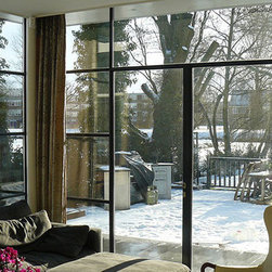 Steel Windows & Doors - Thermally broken steel window wall with French doors.