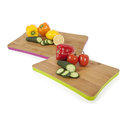 Cutting Board Duo - Why let ingredients have all the fun when it comes to color? With this pair of cutting boards, add a vibrant note to your practical kitchen prep. A large magenta board and a medium lime one pair up to provide enduring and colorful appeal in your kitchen. Made of bamboo harder than traditional hardwoods, you'll find yourself preparing everything from weeknight dinners to holiday banquets with these stylish cutting boards.