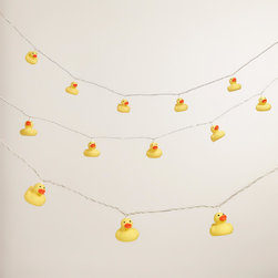 World Market - Rubber Ducky 10-Bulb String Lights - Create festive ambient lighting with our exclusive Rubber Ducky 10-Bulb String Lights. The adorable rubber duckies add a playful spirit to any gathering while bathing your d��cor in a soft glow. Each perfectly priced string features end-to-end plugs for connecting up to three sets, letting you brighten any space without breaking your budget.