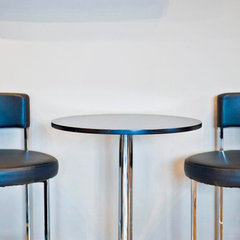 bar tables by Sticks and Stones Design Group inc.