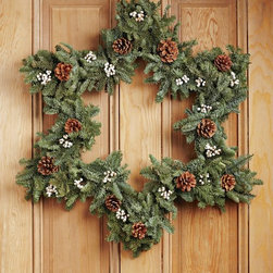 Star Wreath - Step outside the box with a star-shaped wreath. This one will carry a front door from fall through the holidays.