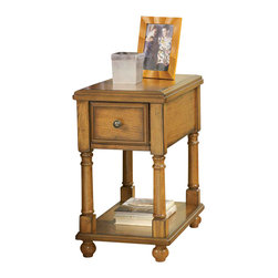 "Signature Design by Ashley - 23"" Height x 13.38"" Width x 22"" Depth - Whether its snuggled up next to your favorite recliner or resting next to the comfort of your sofa, this attractive oak-finish end-table offers ample storage space for your books, magazines and more. Featuring a working front drawer and spacious storage shelf, this side-table will look great in your room or office."