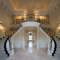Traditional Staircase by John Henry Architect